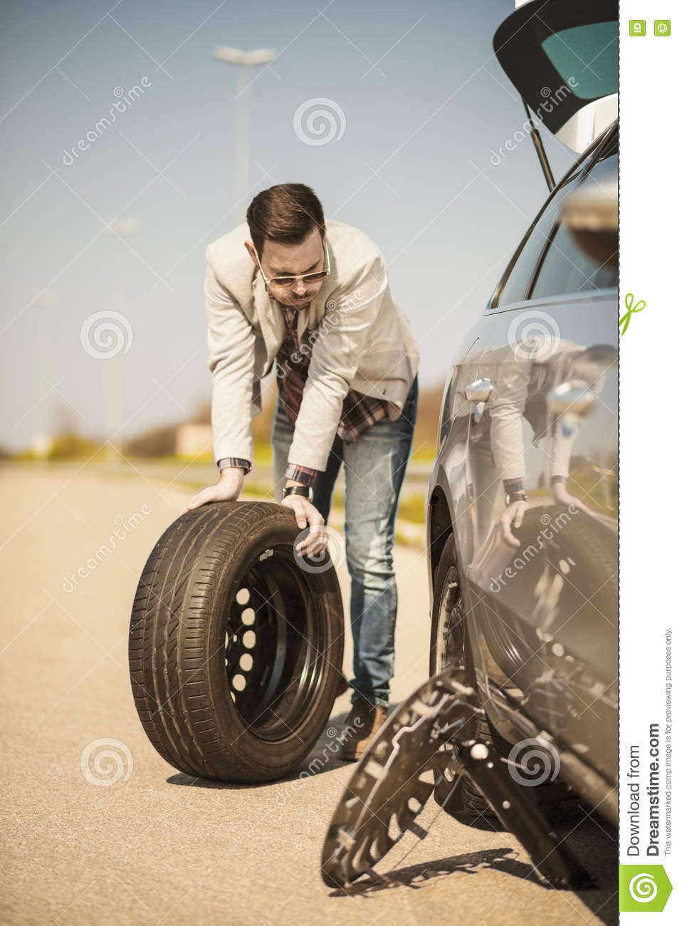 Broken Down Abandoned Stock Photos Broken Down Abandoned: Changing The Tire On A Broken Down Car Royalty-Free Stock