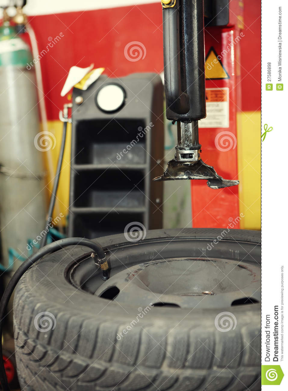 Changing a tire in a garage stock photo image of person for Garage a persan