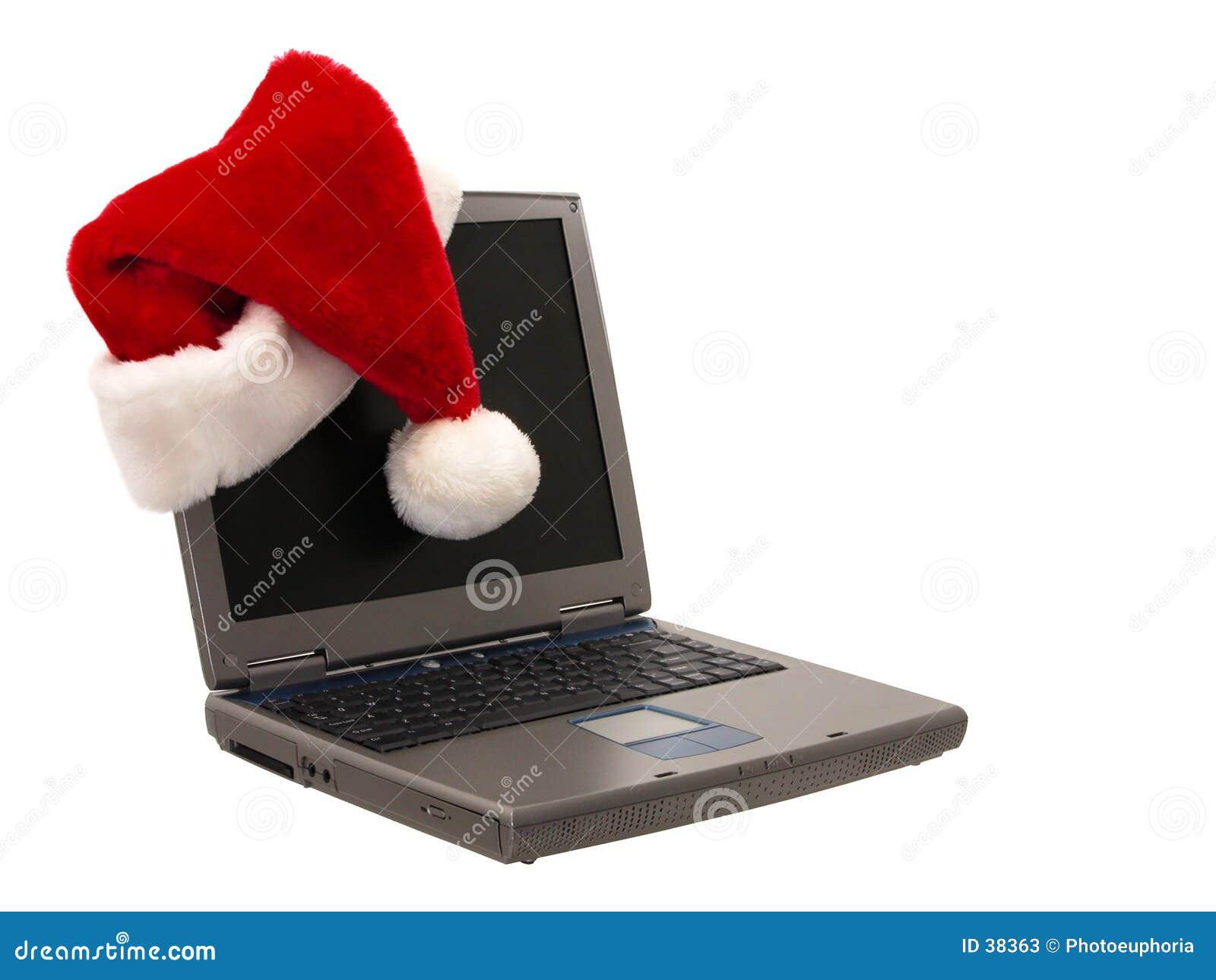 Chapéu de Santa que senta-se em um portátil (2 de 3)