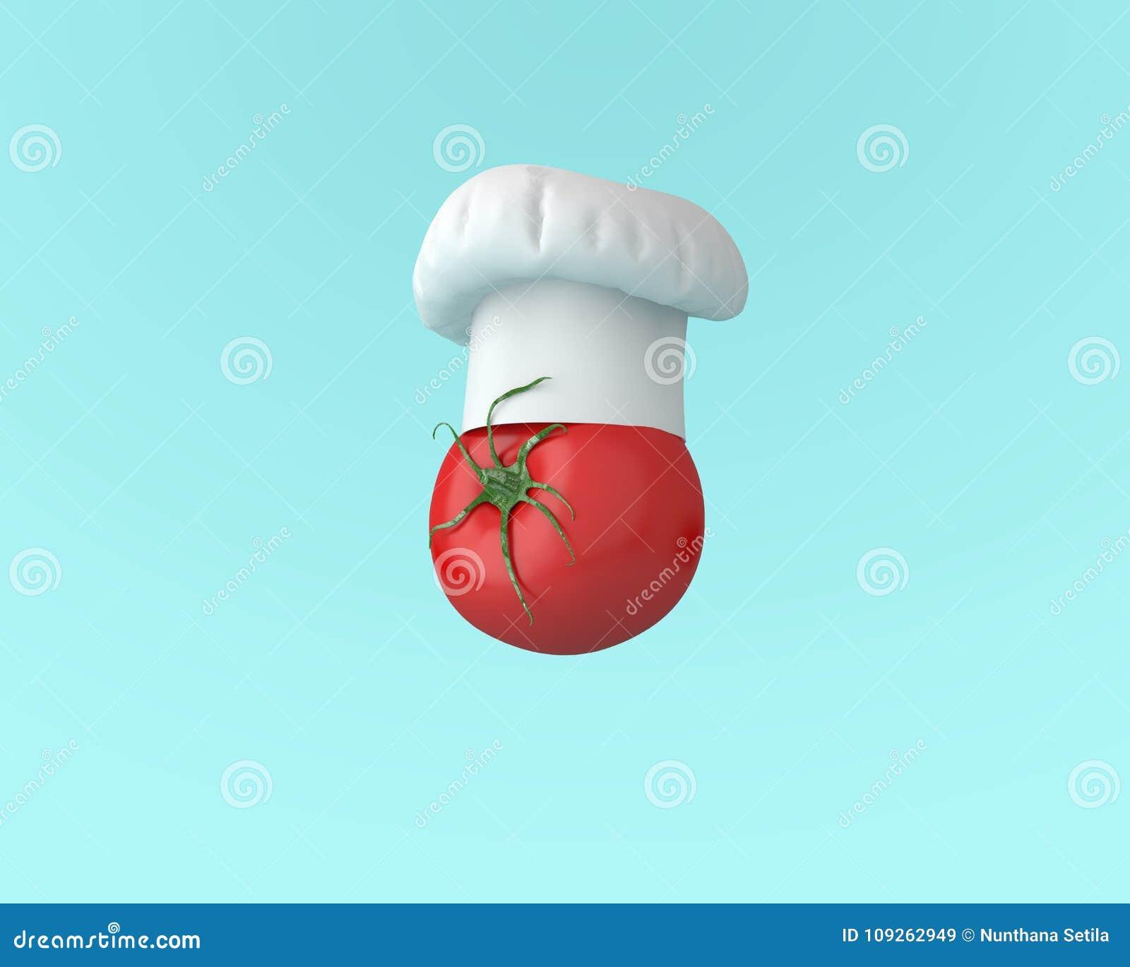 Chapéu do cozinheiro chefe com conceito do tomate no fundo azul pastel mínimo