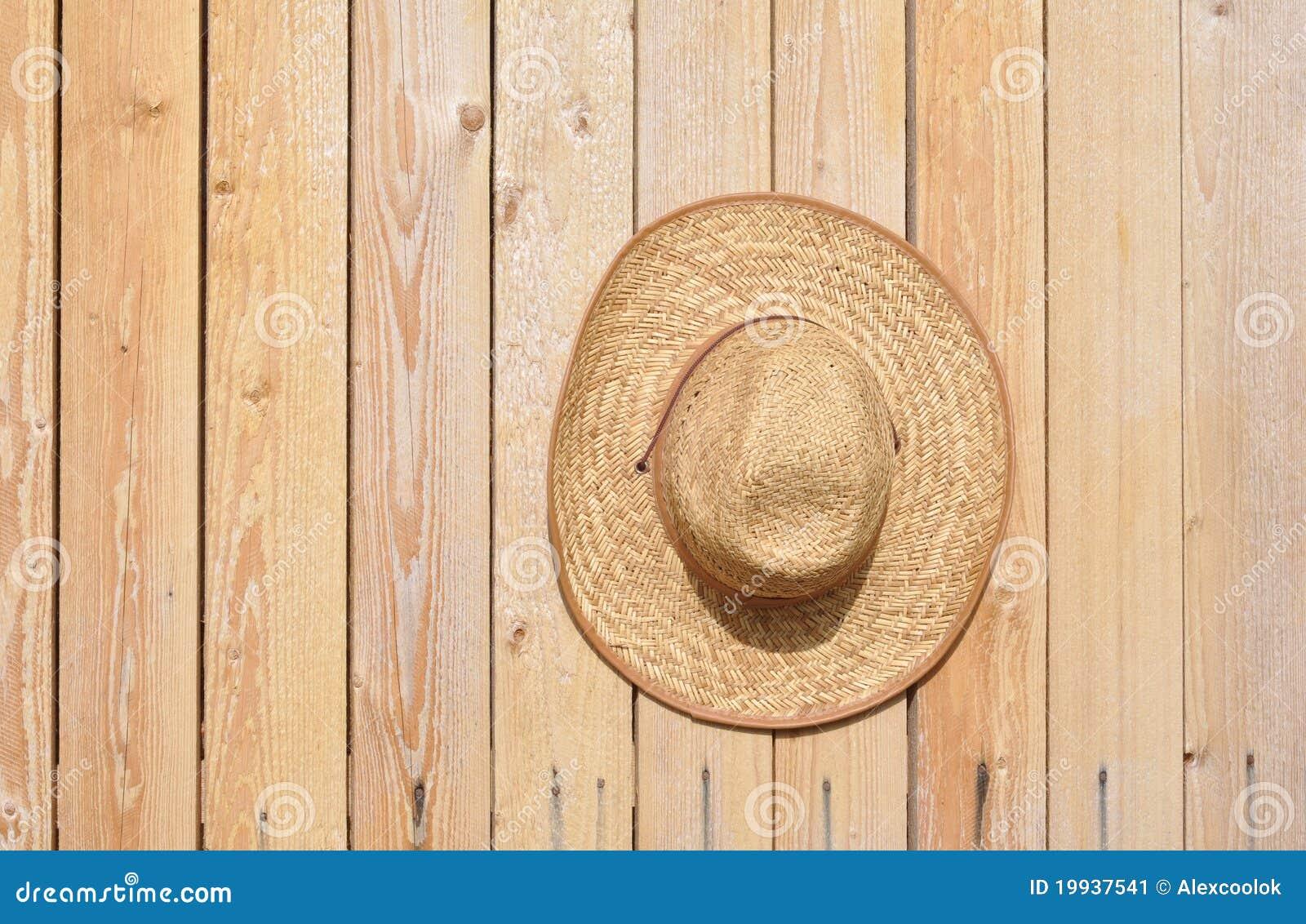 chapeau de paille sur le mur image stock image du couvre costume 19937541. Black Bedroom Furniture Sets. Home Design Ideas