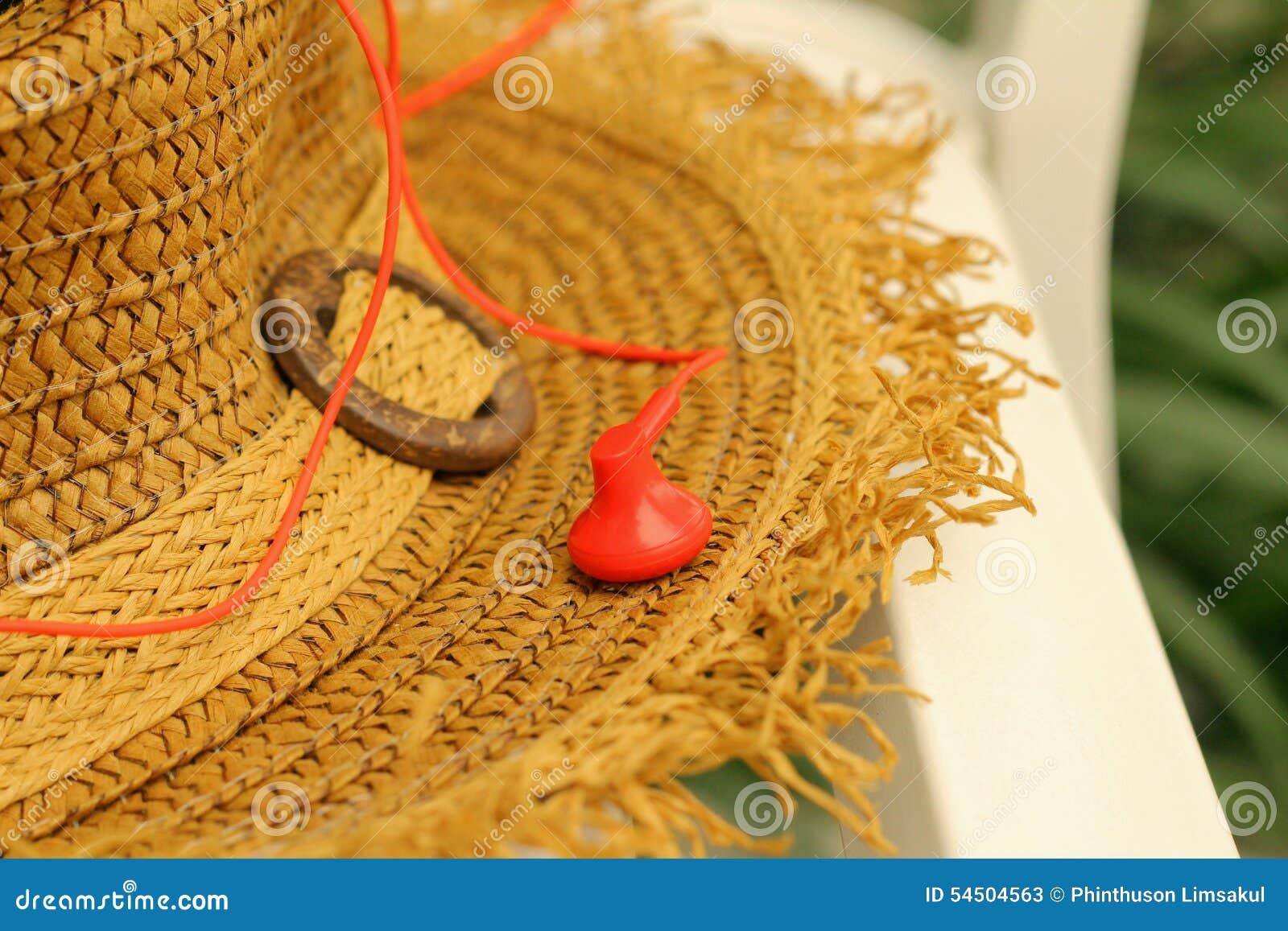 Chapeaux de paille avec l écouteur