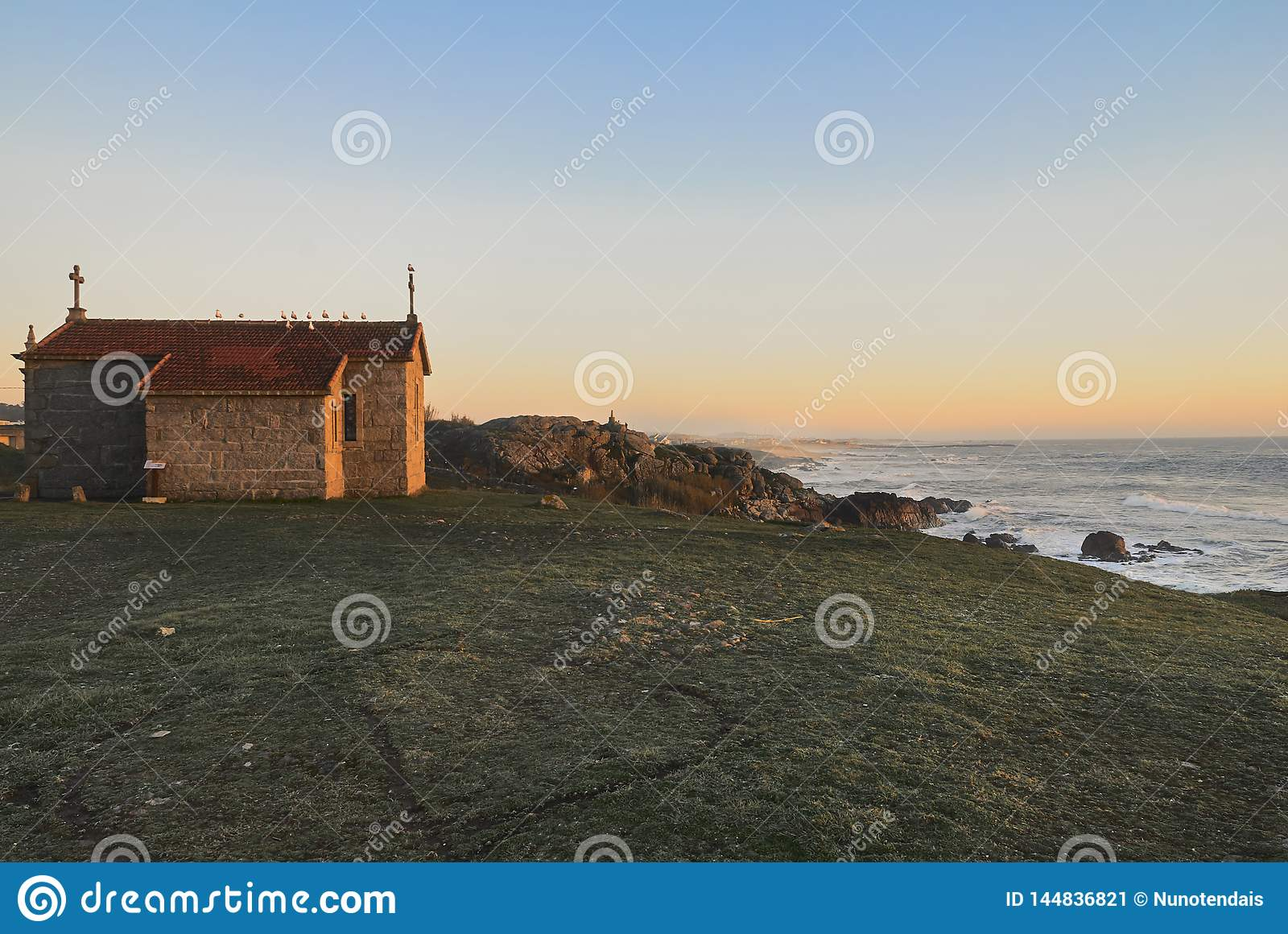 Chapel overlooking the ocean at sunset