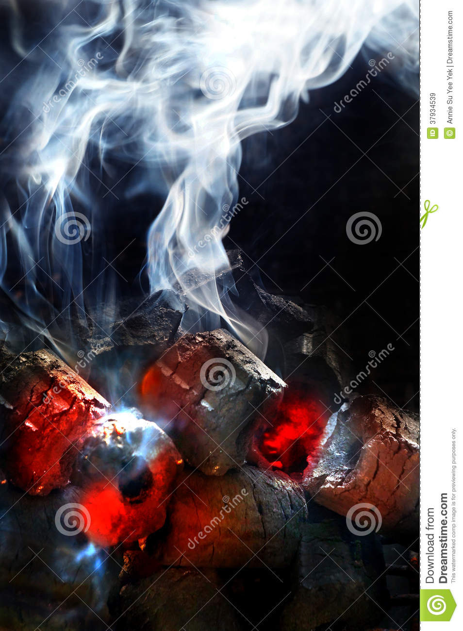 Charcoal fire with white smoke