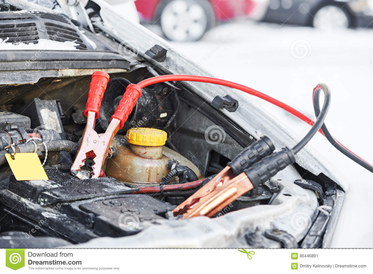 Charging Automobile Discharged Battery By Booster Jumper Cables At