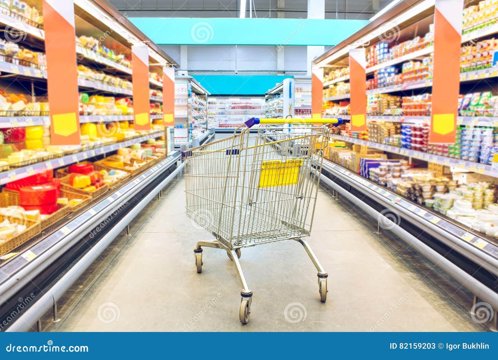Chariot à l épicerie Supermarché intérieur, chariot vide à achats Idées et commerce de détail d affaires