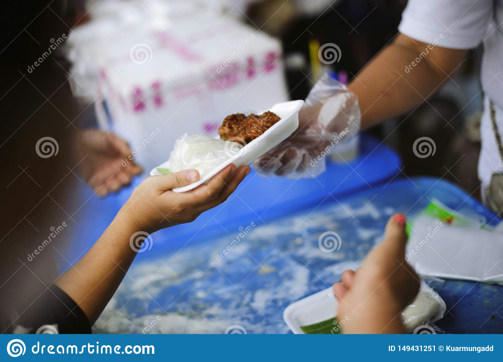 Charity food is the hope of the poor who have no money : concept of begging food : Donate food to people in society : Volunteers