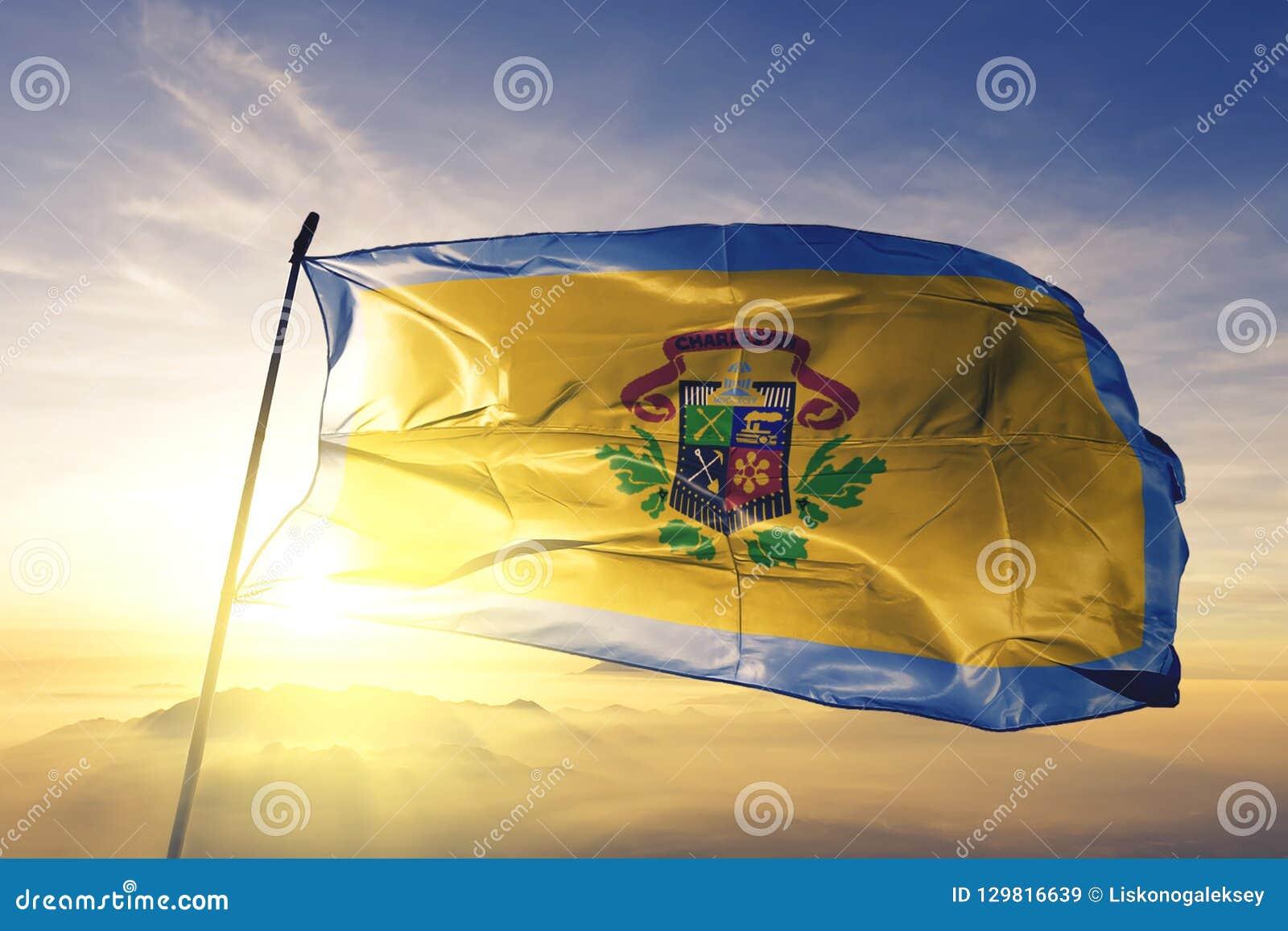 Charleston city capital of West Virginia of United States flag textile cloth fabric waving on the top sunrise mist fog