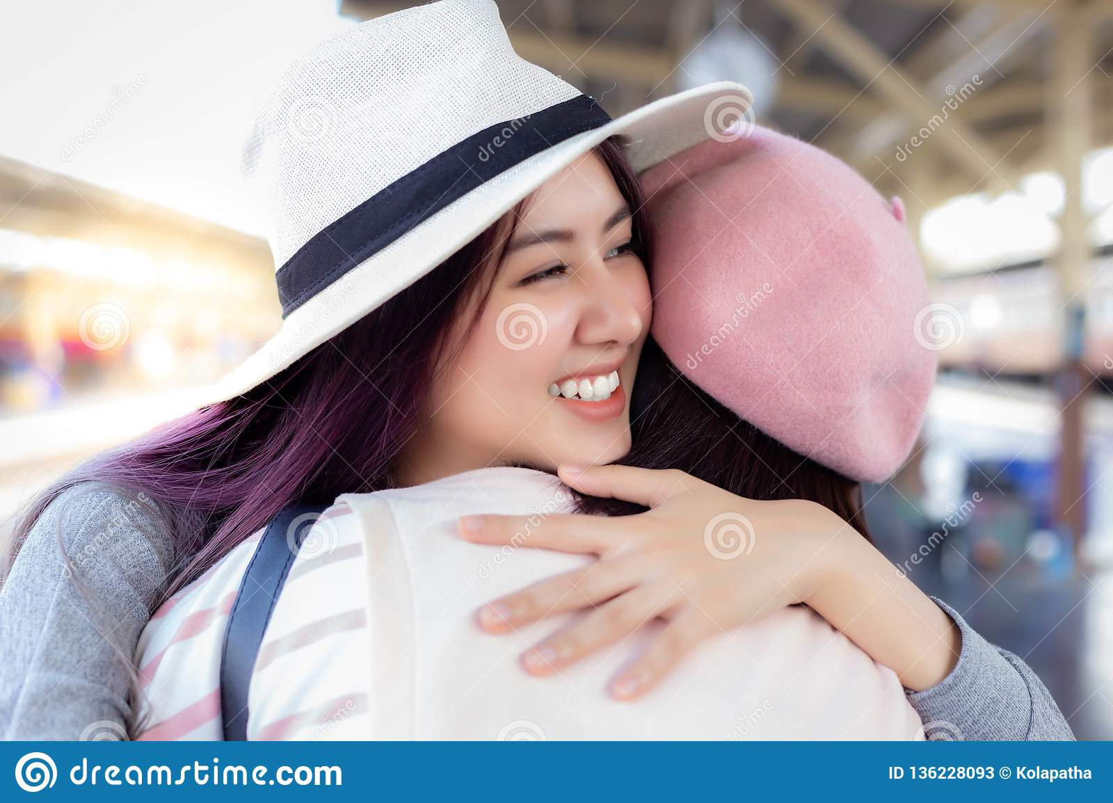 Charming beautiful woman feels very happy when she meets her friend or cousin.