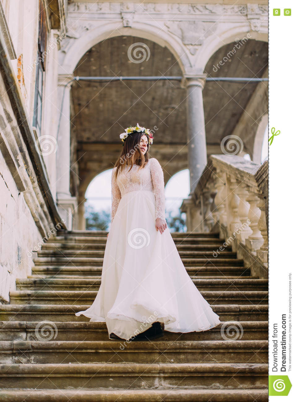 Charming Bride In Long White Wedding Dress And Floral Wreath Going Down By Antique Palace Stone Stairs: Beautiful Stone Wedding Dress At Websimilar.org