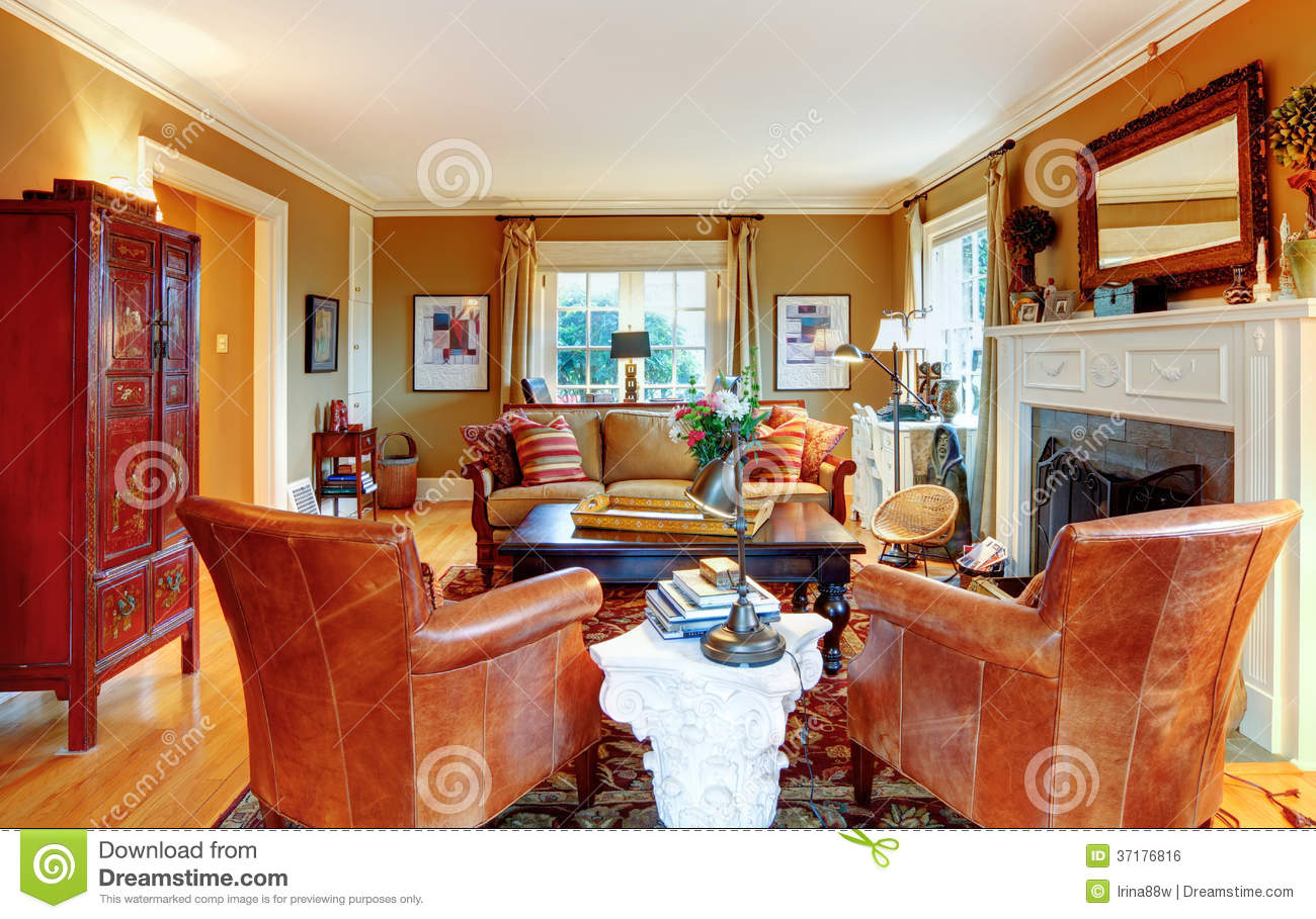 luxury family room with rich furniture and staircase to loft stock