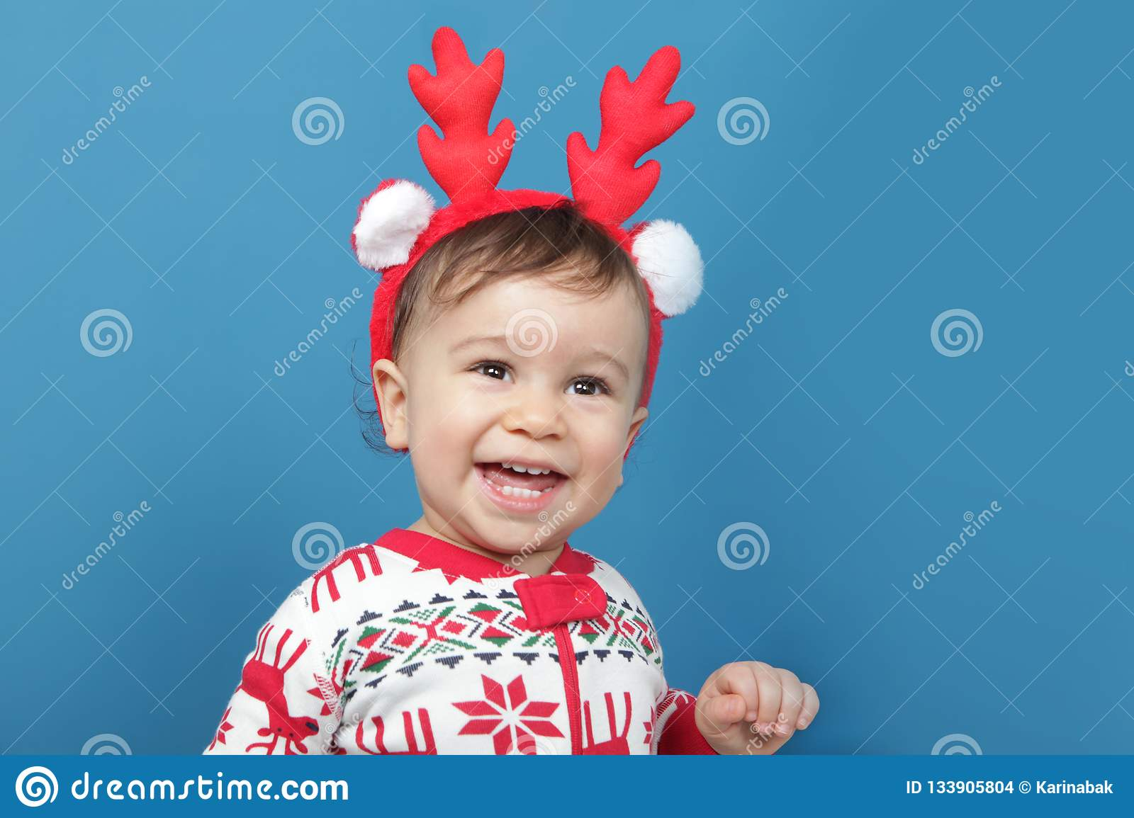 Charming little boy in Christmas pajamas