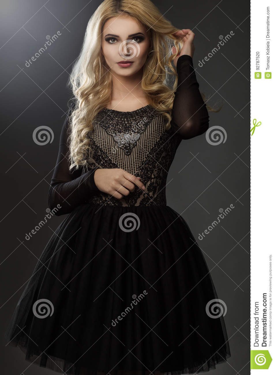 Charming model in black, elegant dress.