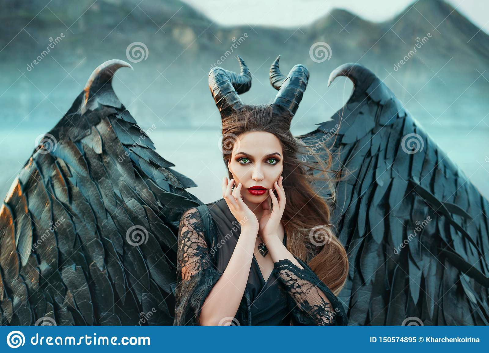 Charming portrait of dark angel with sharp horns and claws on strong powerful wings, wicked witch in black lace dress