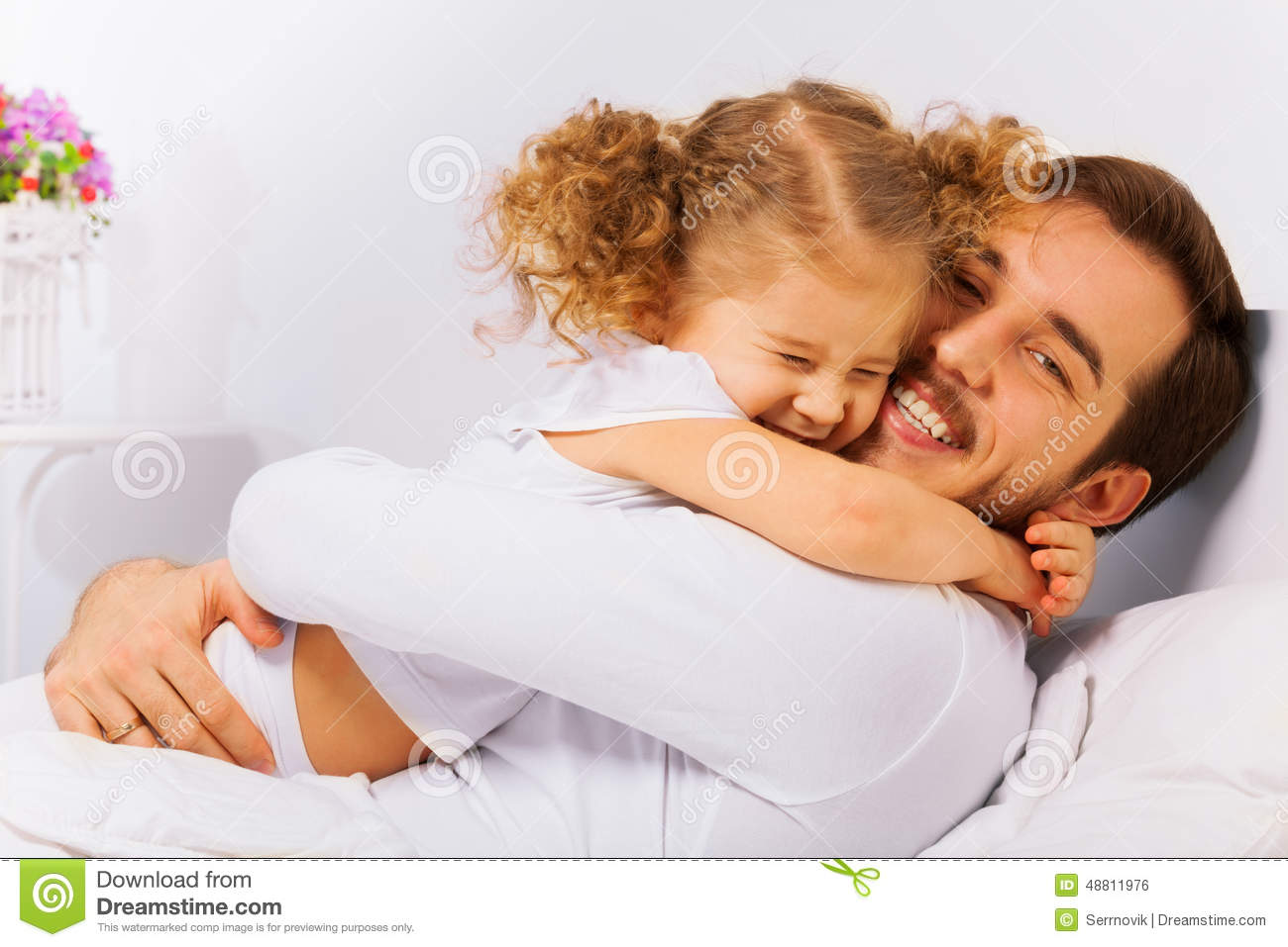 Charming Portrait Of Happy Father And Daughter Stock Photo