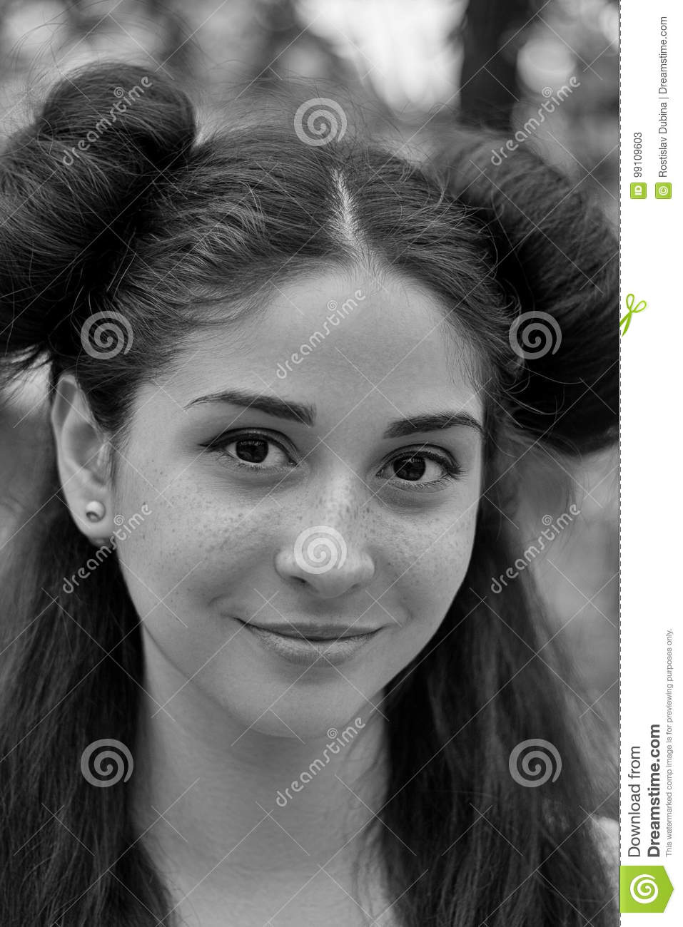 Charming portrait of a young brunette girl with beautiful eyes black and white