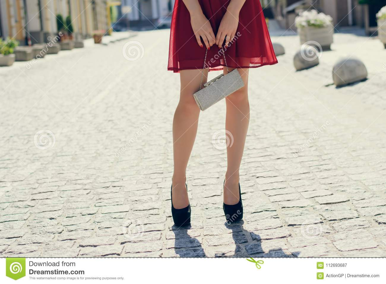 Charming Pretty Lady In Red Dress, With Bag In Hands, In