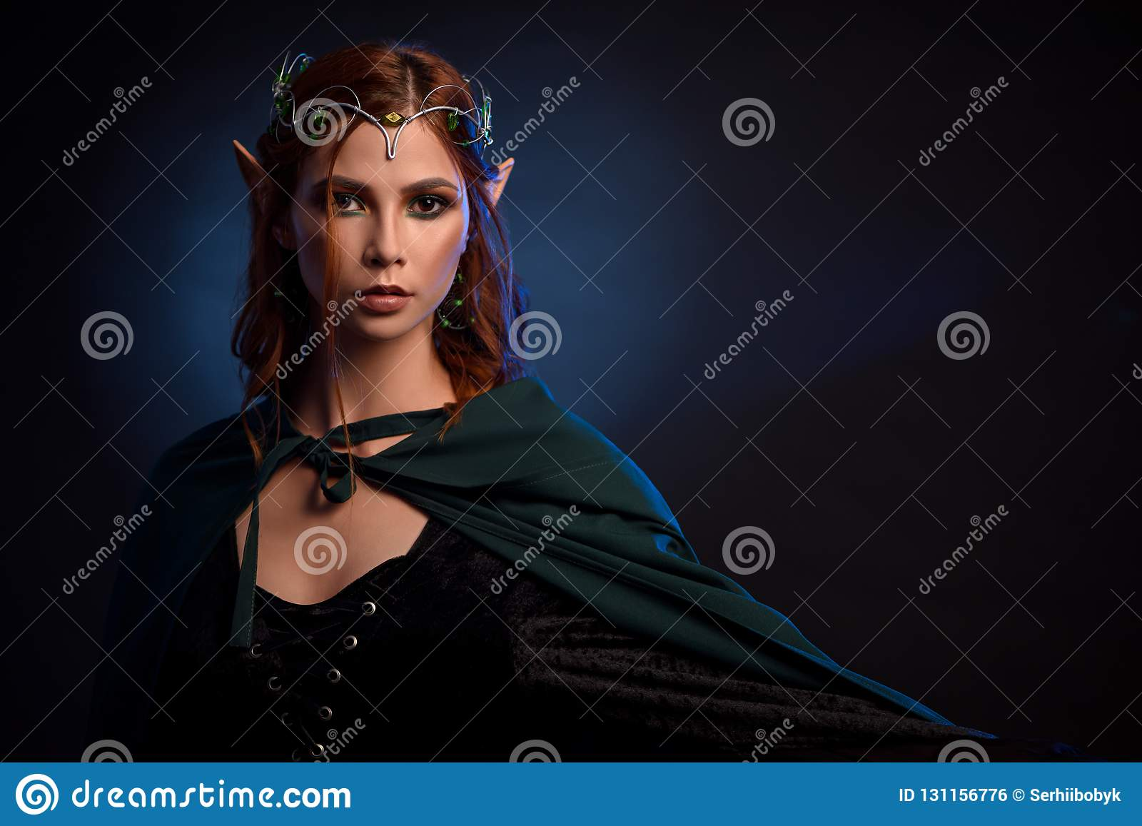 Charming Queen Of Elves In Silver Tiara And Red Hair Stock Photo