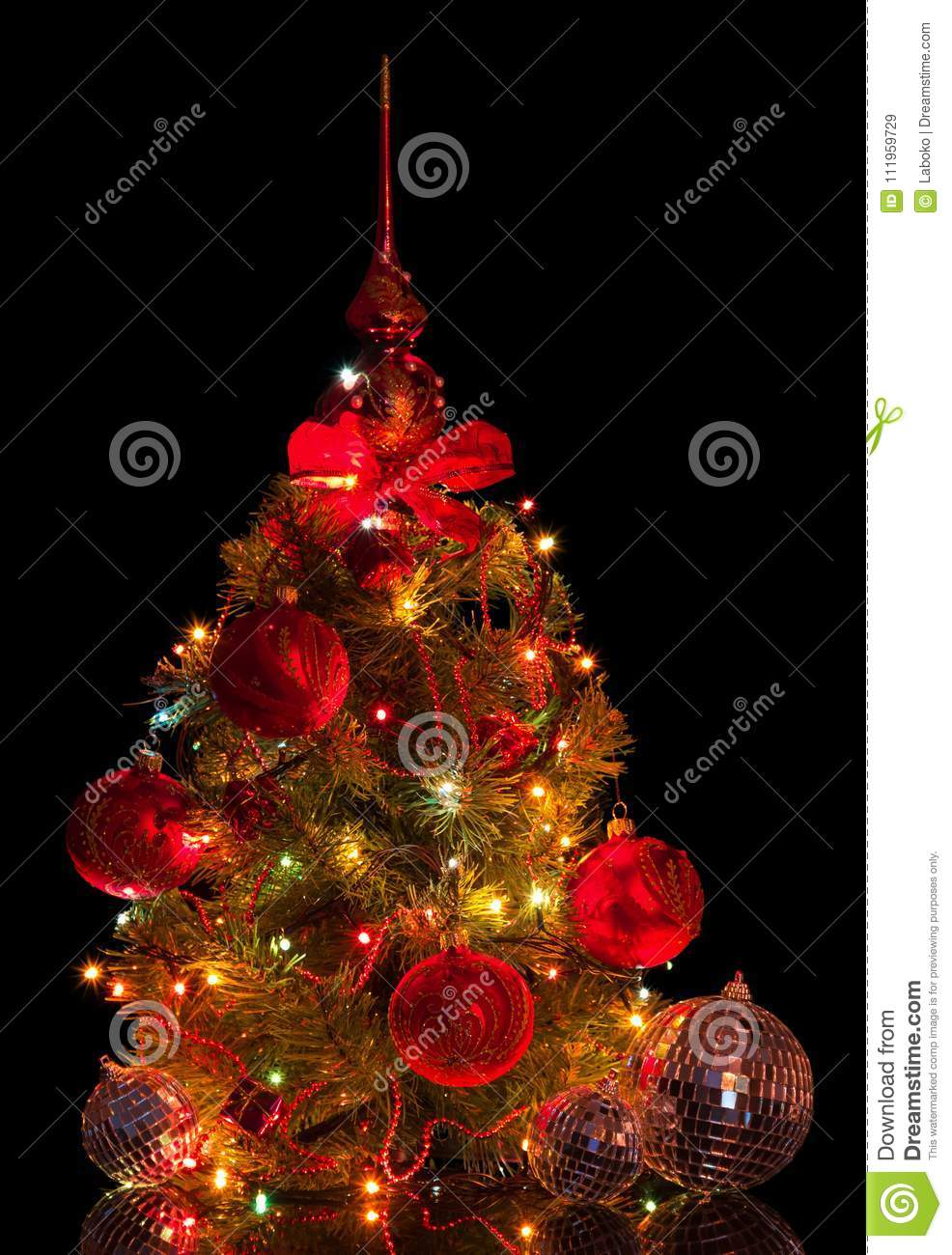 download charming small christmas tree with mirror balls beads and garland isolated on black