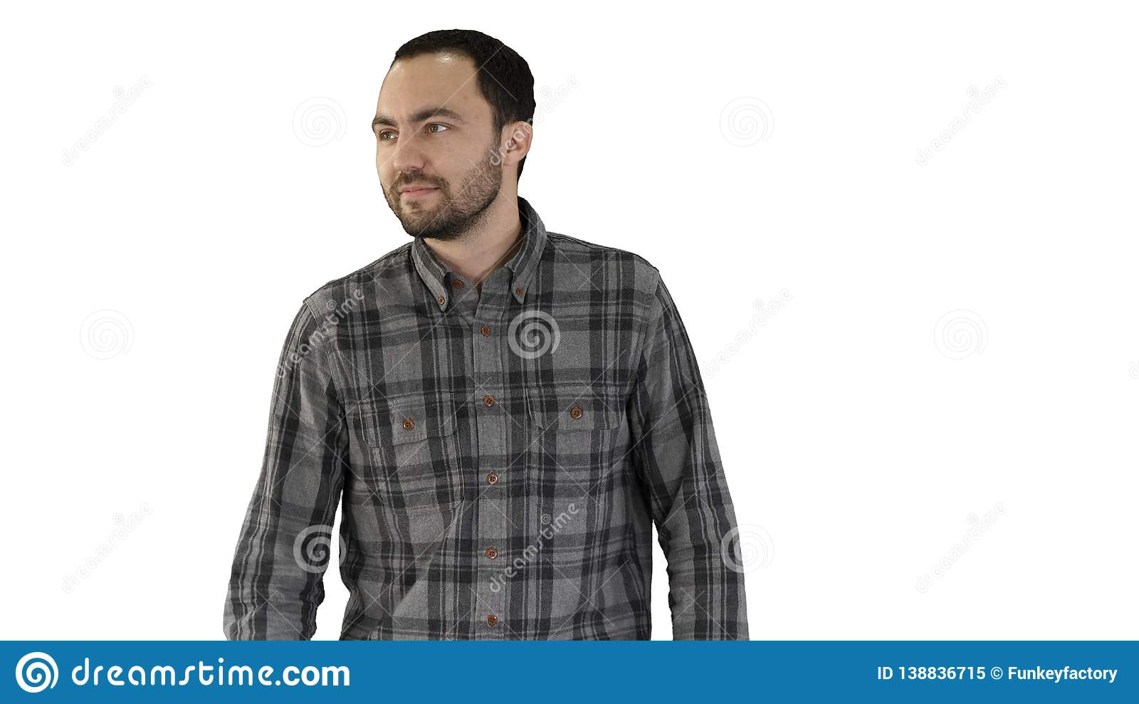 Charming successful young entrepreneur in walking and looking to the sides on white background.