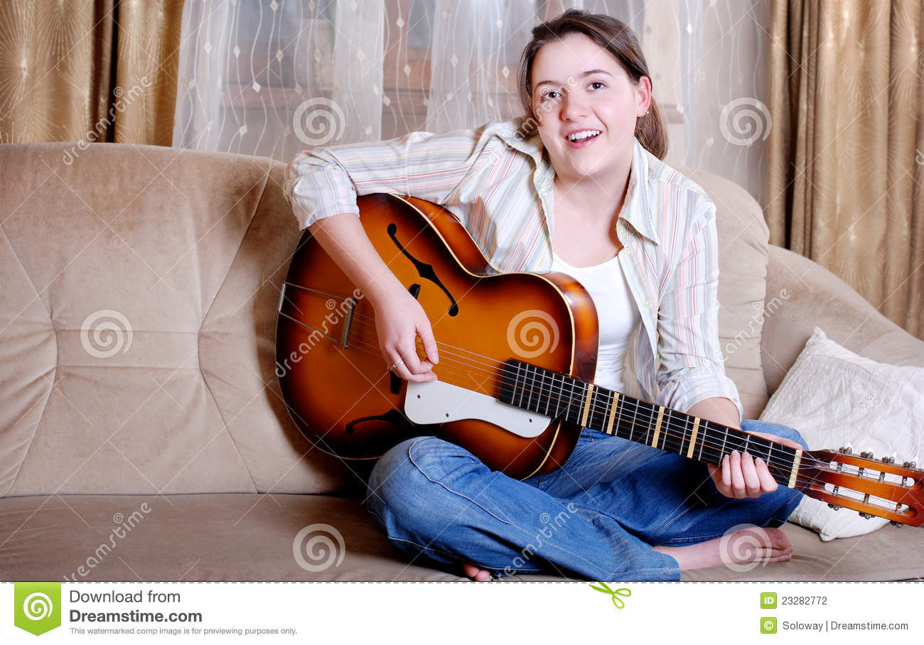 Charming teenage girl play by guitar stock photography image 23282772 - Charming teenage girls image ...