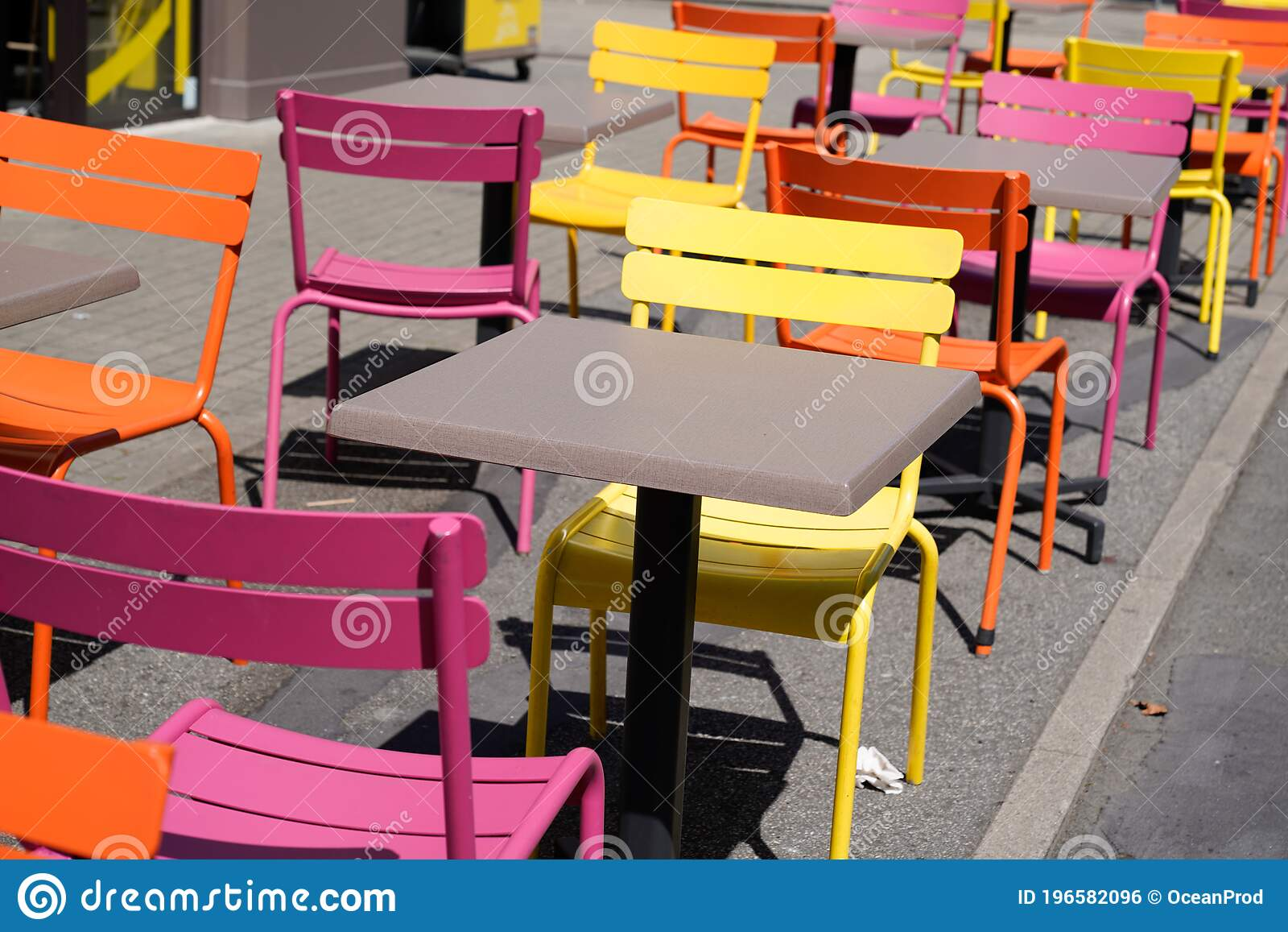 Charming Yellow Orange And Pink Chairs On Cafe Outdoor Restaurant Cafe And Wooden Tables Colorful Terrace Stock Photo Image Of Outside Background 196582096