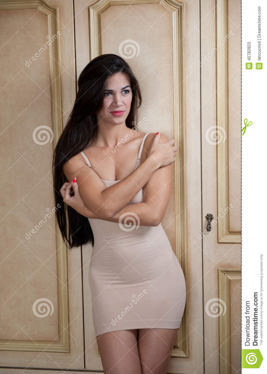 Charming Young Brunette Woman In Tight Fit Short Nude ...