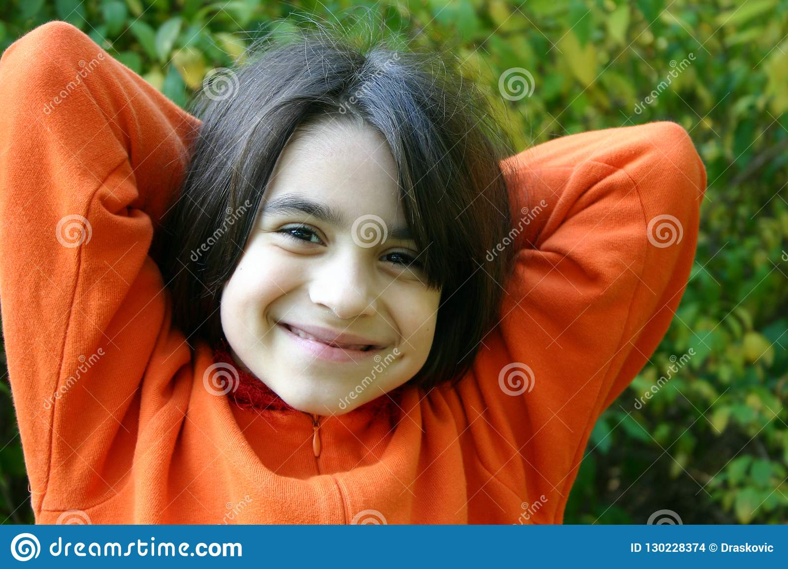 Charming young girl with orange jacket
