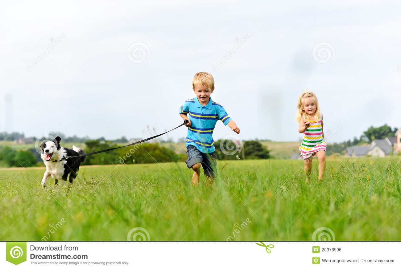 Chasing my brother and the dog in the field
