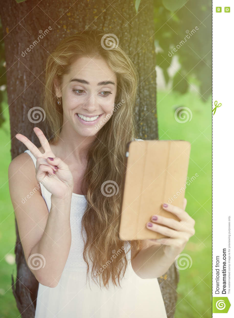 Download Chatting under the tree stock photo. Image of mobile - 77048366