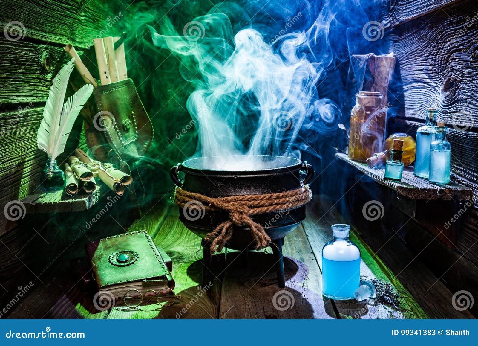 Chaudron de witcher de vintage avec les breuvages magiques magiques et les livres pour Halloween