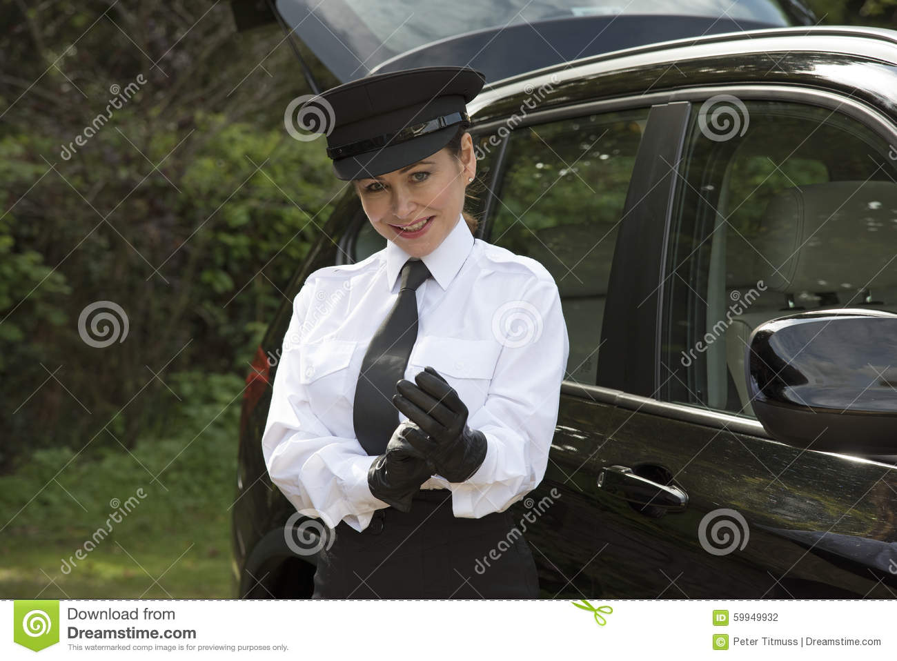 Black leather uniform gloves - Chauffeur Putting On Her Driving Gloves