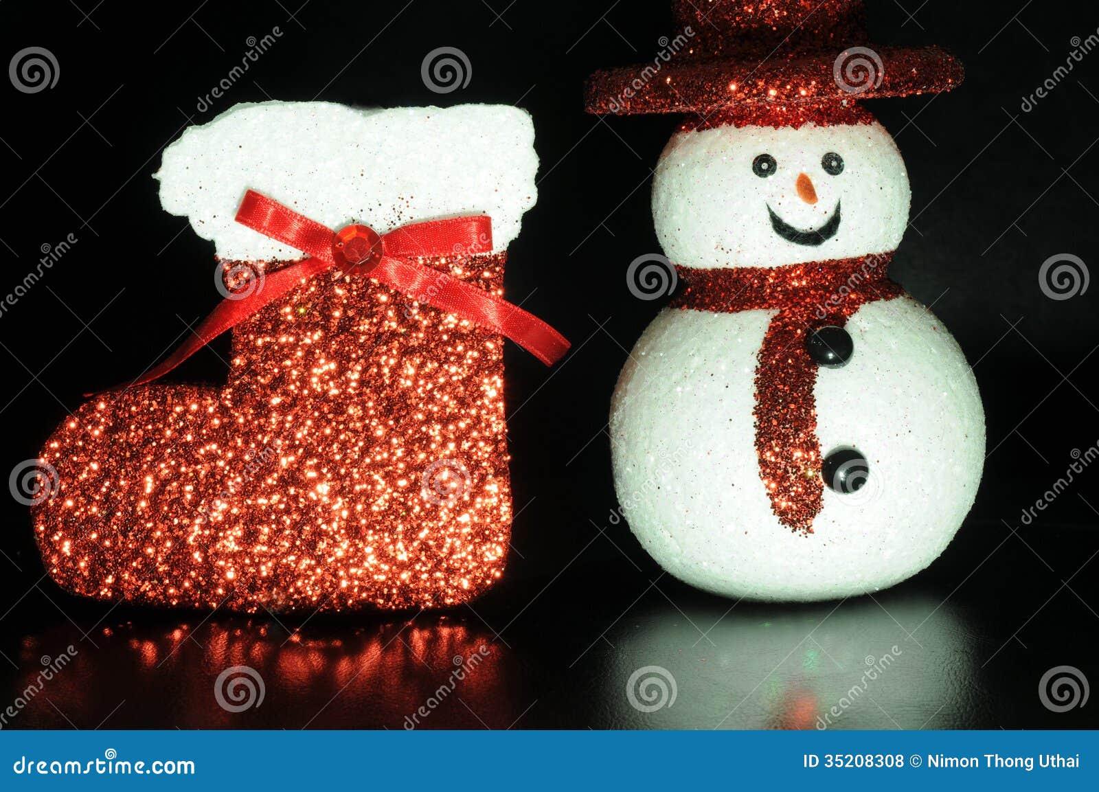 chaussette rouge de noël avec le bonhomme de neige photo stock