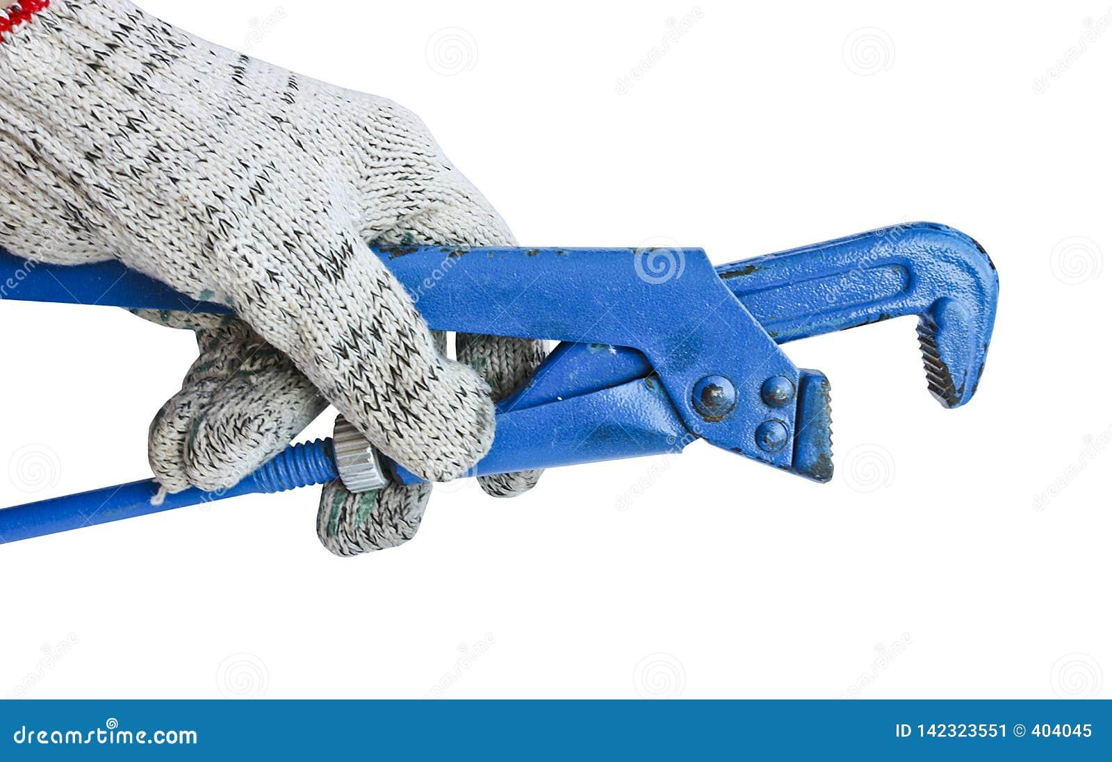 Chave ajustável do gás na mão de um homem em uma luva de trabalho Ferramenta do serralheiro
