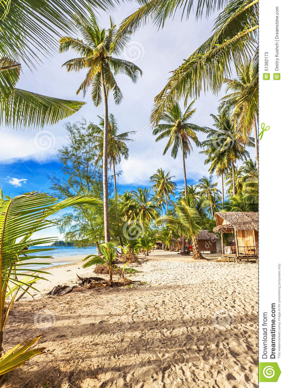 Cheap bungalows on a tropical beach stock photo image for Tropical vacation on a budget