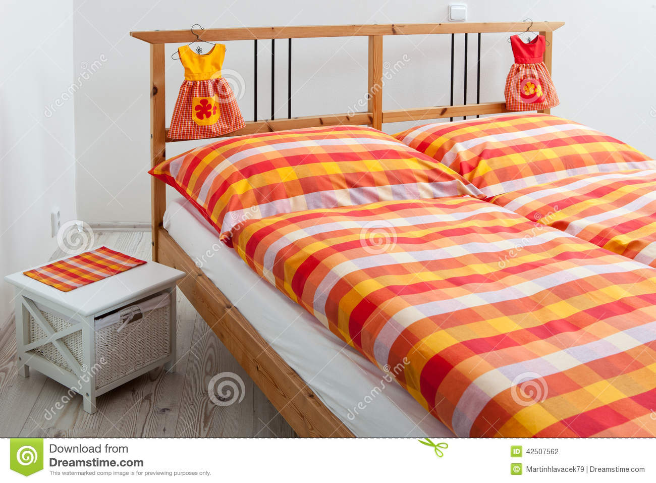 Checkered Bedding In Interior Of Bedroom Stock Photo