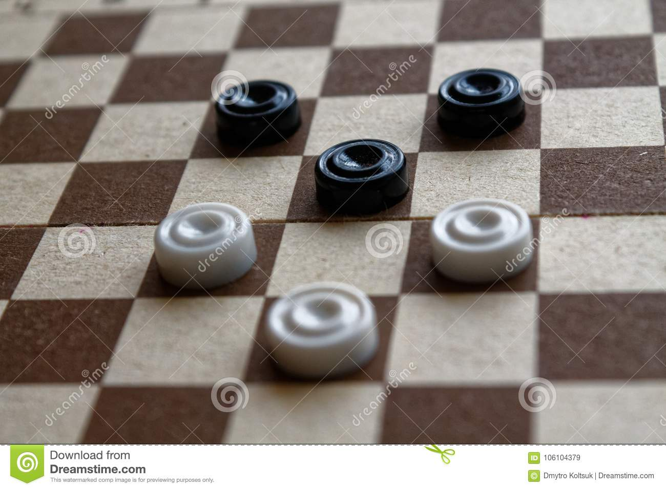 Checkers in checkerboard reday for playing. Game concept. Board game. Hobby. checkers on the playing field for a game.