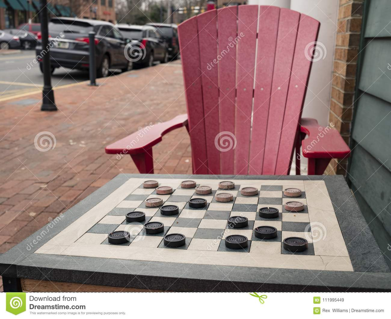 checkers game in public on sidewalk