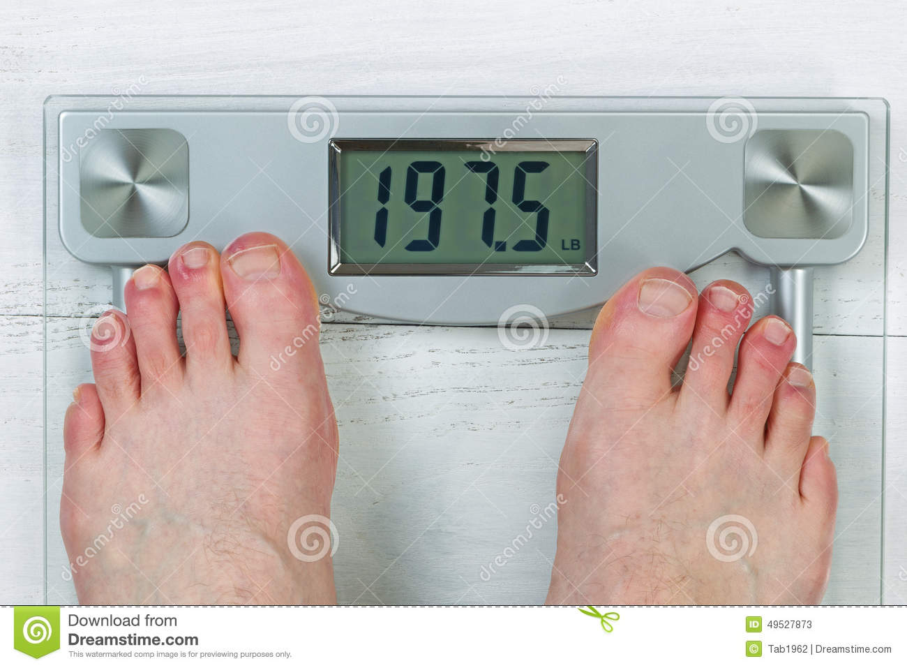 Checking Body Weight On Scale Stock Photo
