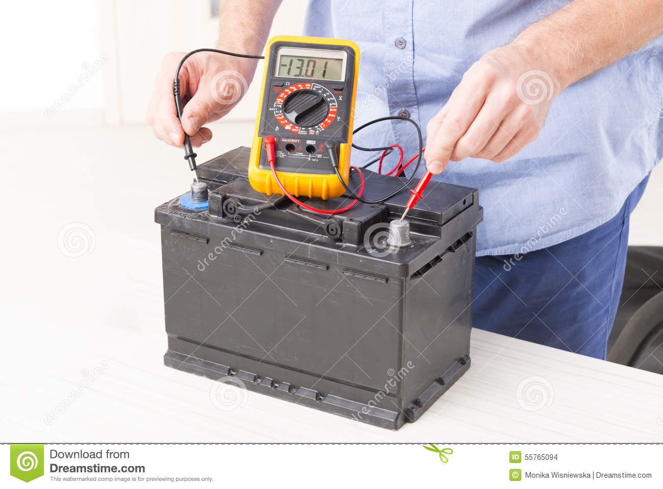 checking car battery stock photo image of tool multimeter 55765094. Black Bedroom Furniture Sets. Home Design Ideas