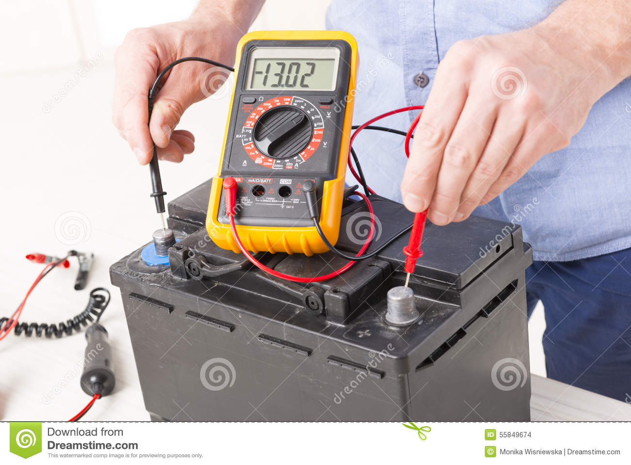 Checking A Car Battery With A Voltmeter