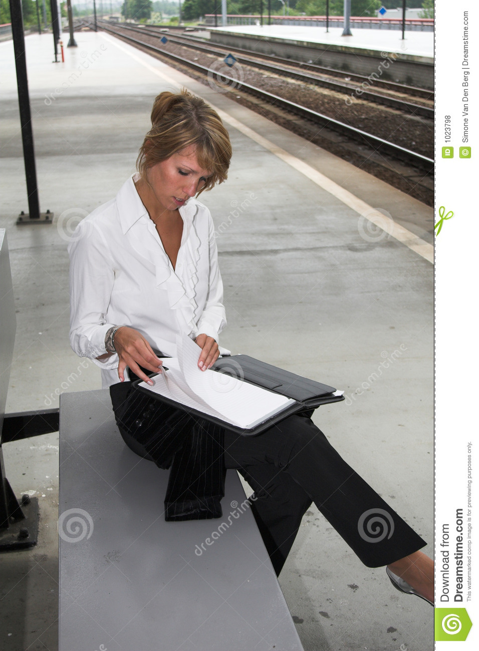 Checking her notes at the trainstation