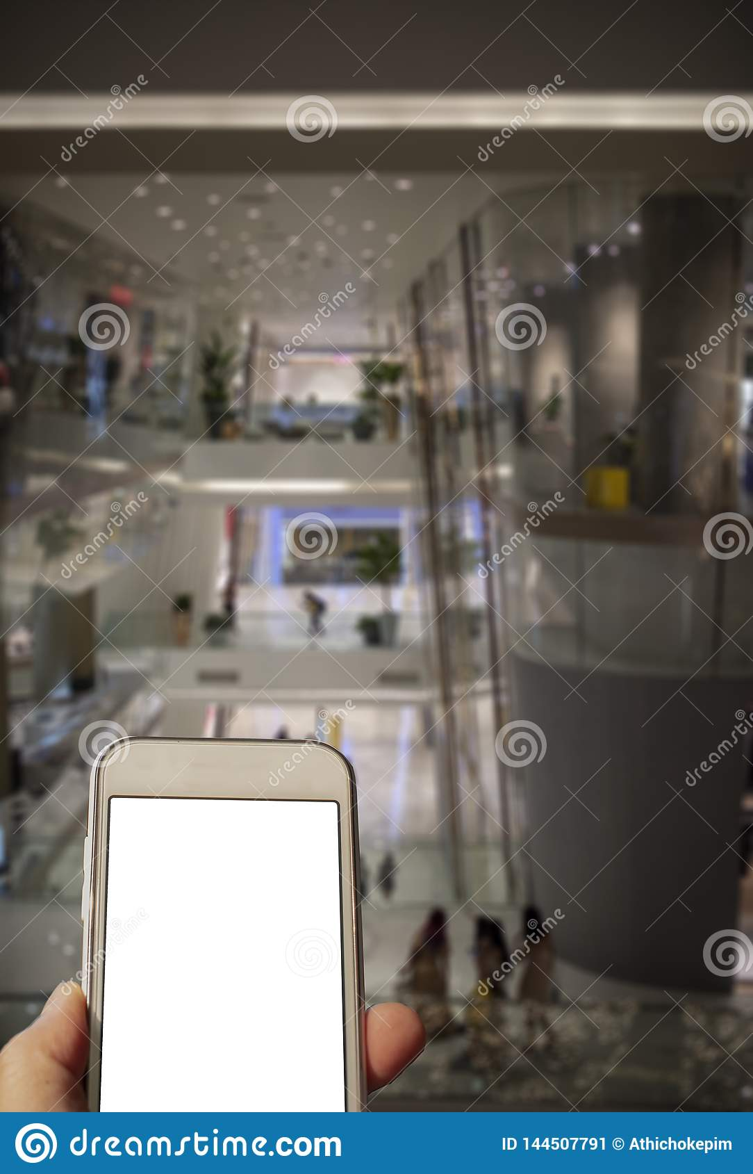 Checking a mobile phone while shopping.