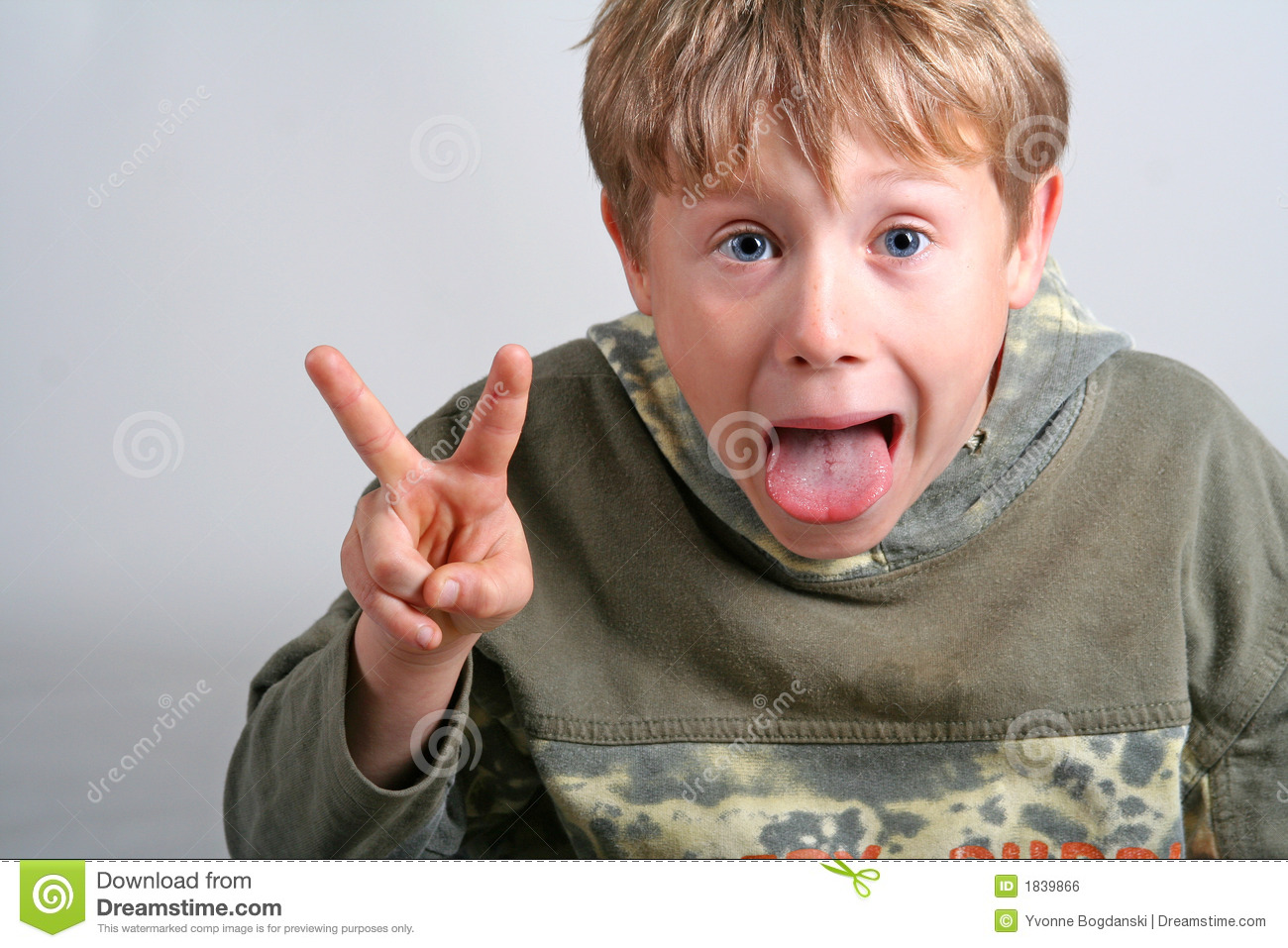 Cheeky Boy Making Funny Face Stock Photo - Image of male ...