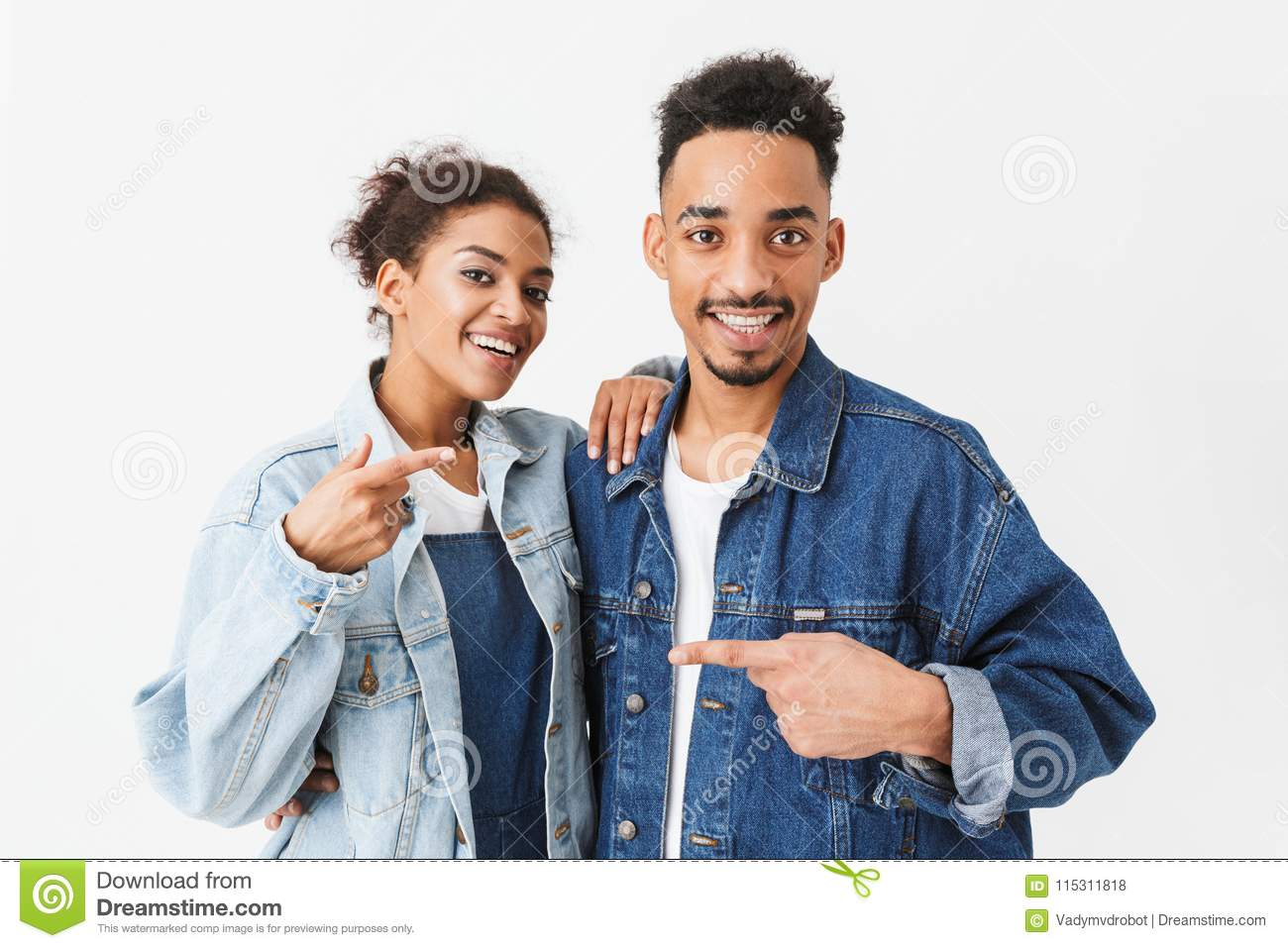 4c4aa74ca64 Cheerful African Couple In Denim Shirts Pointing To Each Other Stock ...