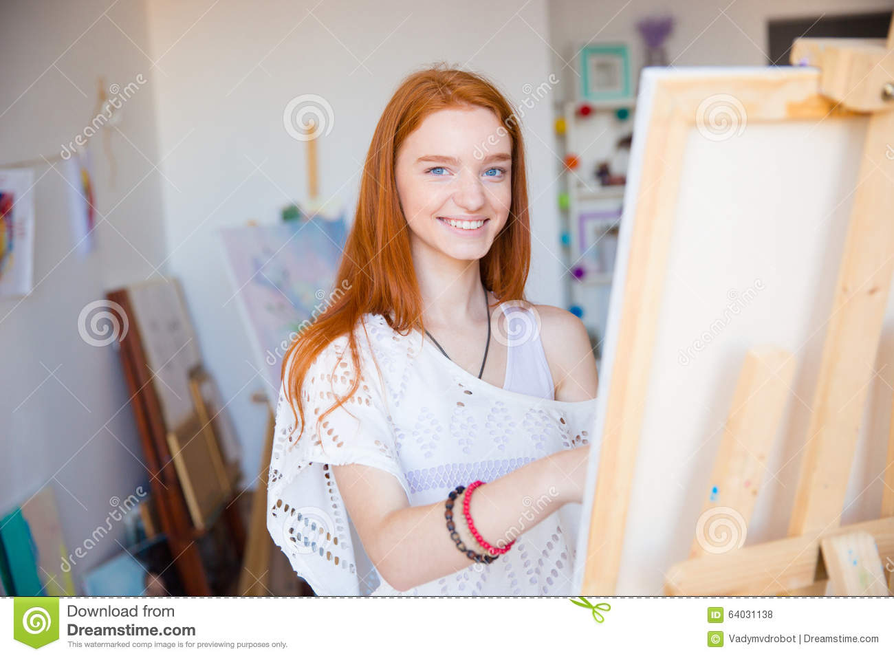 Cheerful Attractive Woman Artist Painting On Canvas In Art