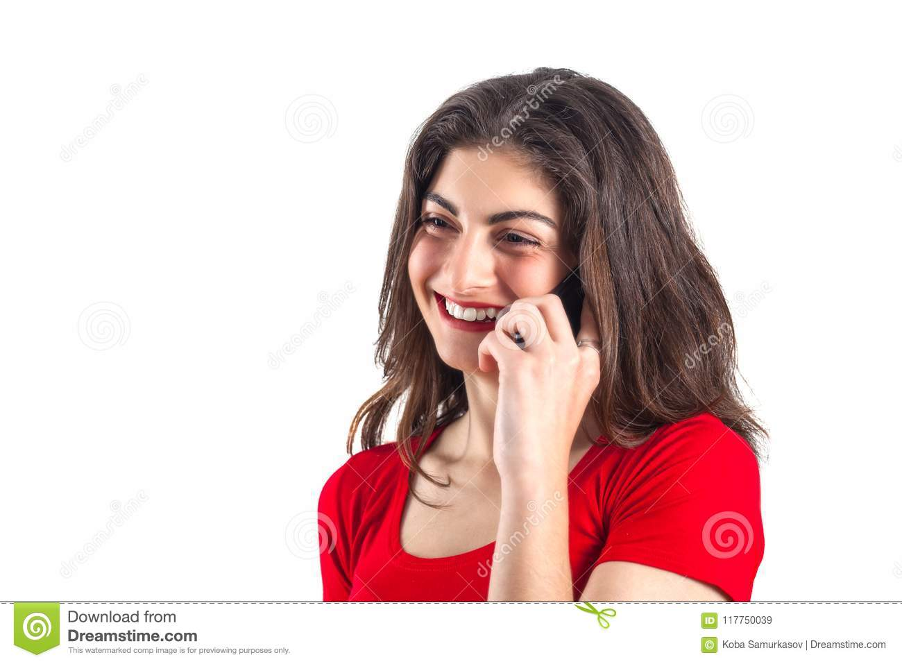 Cheerful attractive young sportswoman using mobile phone over white background