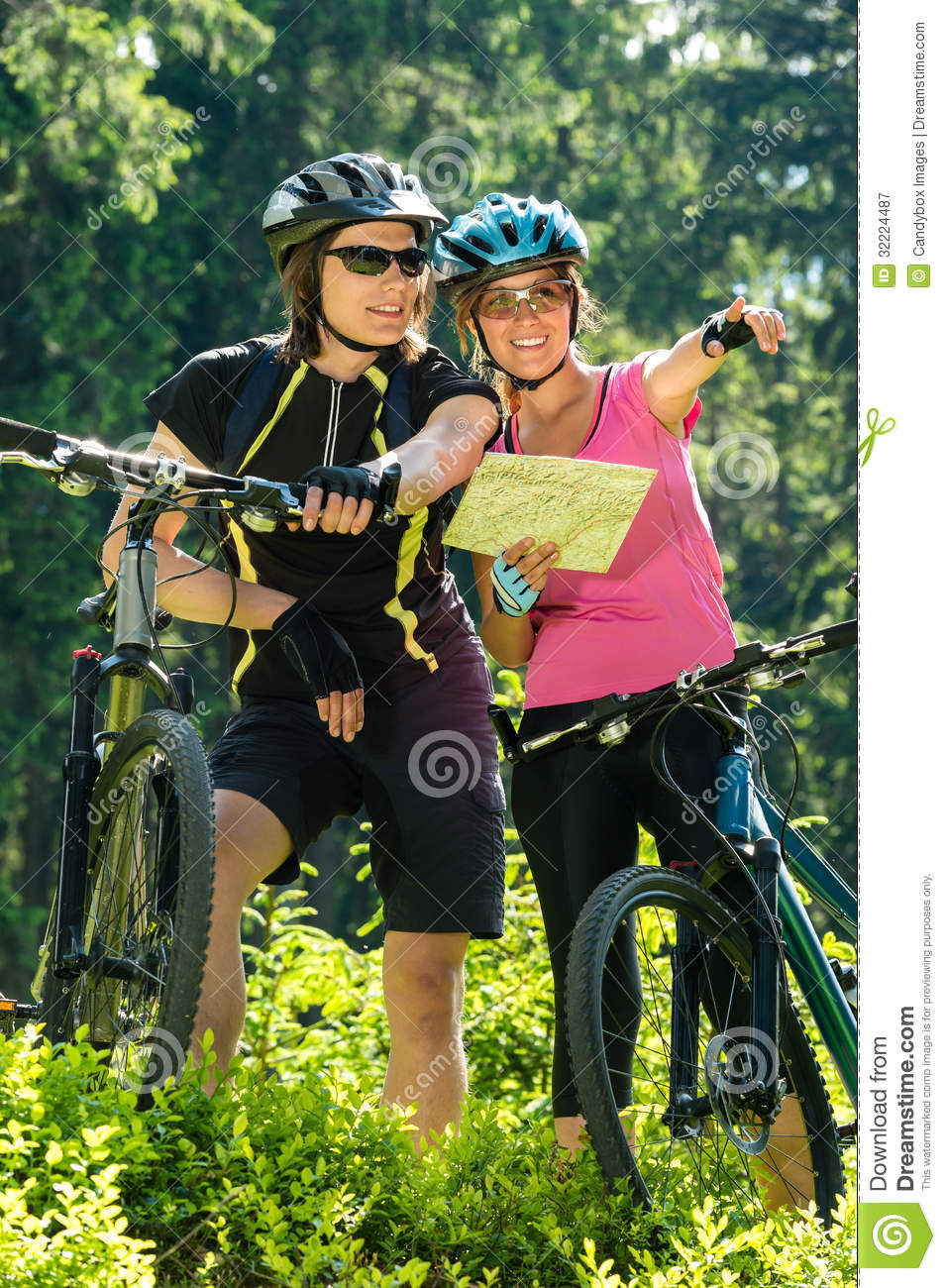 Cheerful bikers checking the map royalty free stock for Cheerful nature