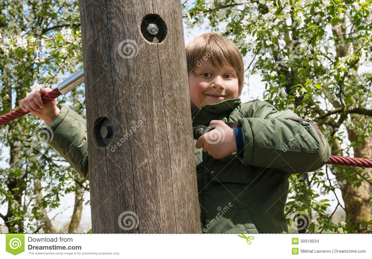 Cheerful blond boy at playground