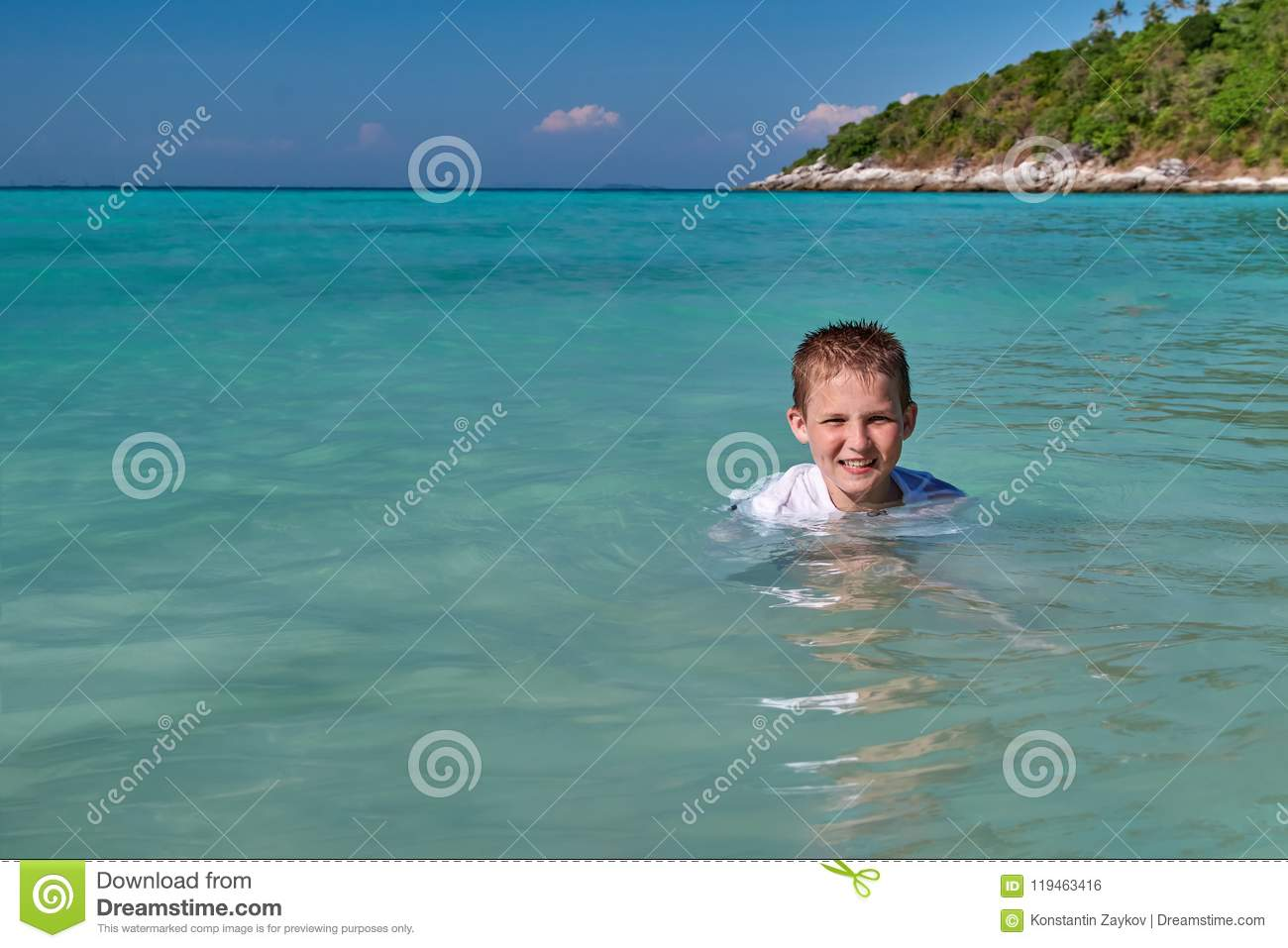 Cheerful Boy Bathes In The Tropical Sea, Sunny Day  Cute